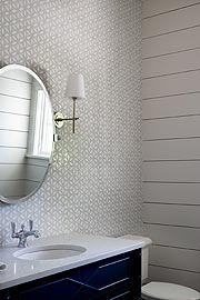bathroom interior with round mirror