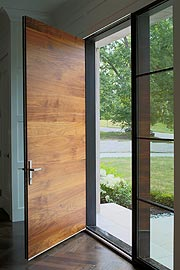 wood front door with custom window